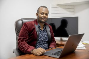 The cost of practicing journalism for an Ethiopian reporter? A jail cell, a caravan across the Sahara, a raft on the Mediterranean — and exile in Minnesota.